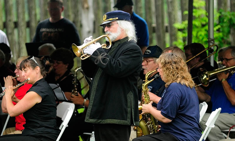 Dennis Harrington plays a cornet that belonged to R.B. Hall during the 33rd R.B. Hall Day Music Festival on Saturday at Old Fort Western in Augusta. Harrington said that the cornet was given by the city of Bangor to musician, bandmaster and composer of marches Robert Browne Hall in 1884. It was on loan, to be played at festival by Reddington Museum in Waterville. There were more than 10 community bands playing at the event.