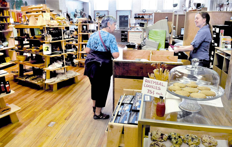 Barrels Community Market employee Suzanne Menair, right, speaks with customer Maggie McKinney at the downtown Waterville store. The business has grown enough that it will become independent of the Main Street Waterville organization that assisted its development.