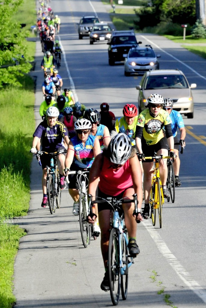 Bicyclists participating in the American Lung Association's 29th annual Trek Across Maine fundraiser ride along Route 137 in Winslow on Sunday.