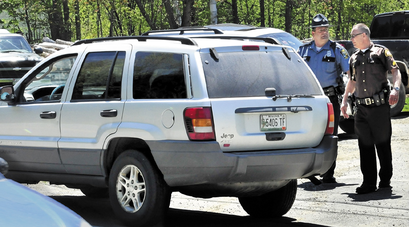 Police from several agencies converged at a residence on the Middle Road in Skowhegan, Wednesday, May 15, after Ernest Almeida, of Waterville, abandoned his vehicle, foreground, following a high speed police chase.