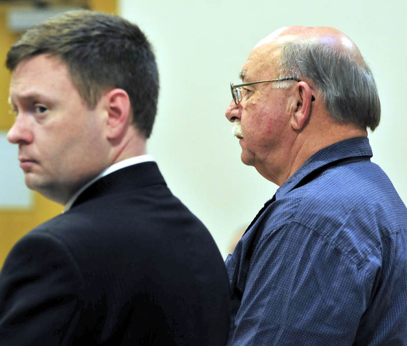 Horace Barstow, right, pleaded guilty Wednesday to four counts of unlawful sexual contact with children under the age of 14. He was sentenced in Skowhegan District Court to four years in prison. His attorney William Logan is beside him.