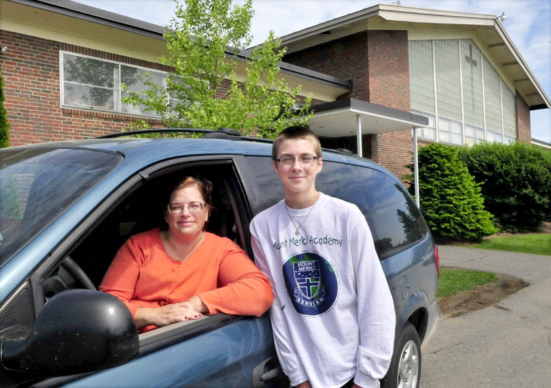 Linda Theberge, of Madison, and her son, Ryan, outside the Mount Merici Academy in Waterville on Thursda. Linda Theberge has logged more than 300,000 miles transporting Ryan and other kids to school for 25 years.
