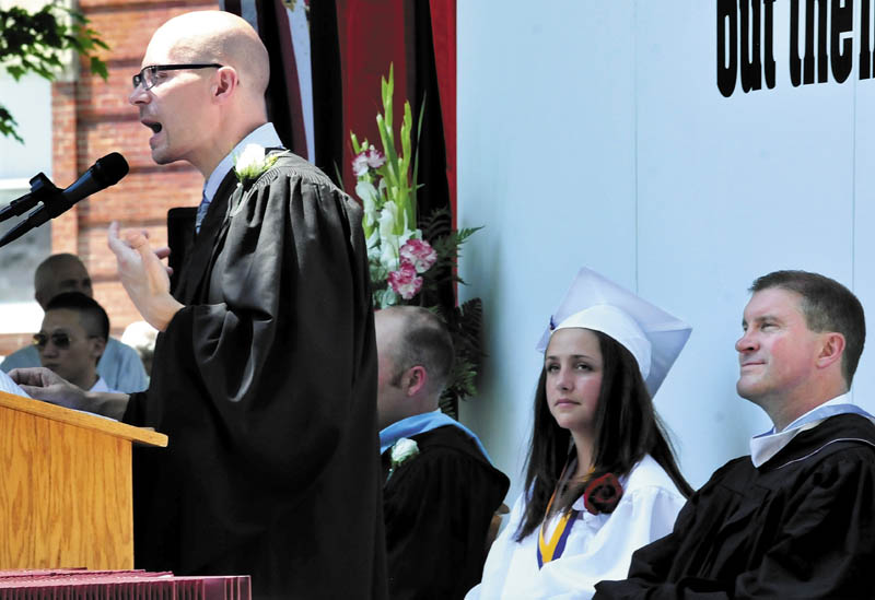 Staff photo by David Leaming KINDNESS: Maine Central Institute commencement speaker Michael Chase, creator of the Kindness Center, delivered his message to graduates in Pittsfield on Sunday, June 2, 2013. At right is valedictorian Brittany Seekins and Headmaster Christopher Hopkins.