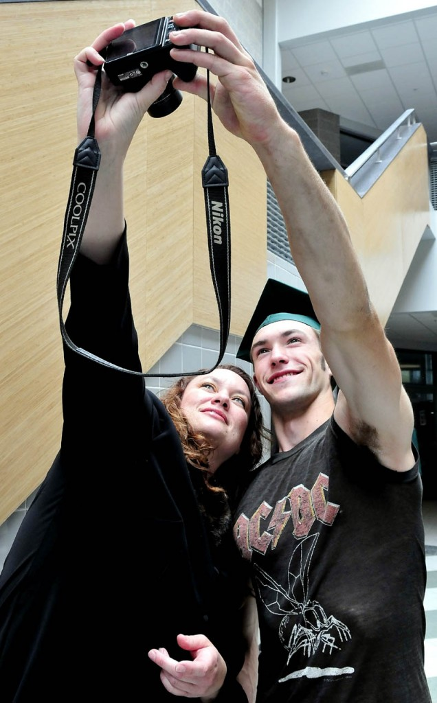 Mount View High School graduate Noah LaForge and his mother, Terri, take a self portrait prior to commencement in Thorndike on Saturday.