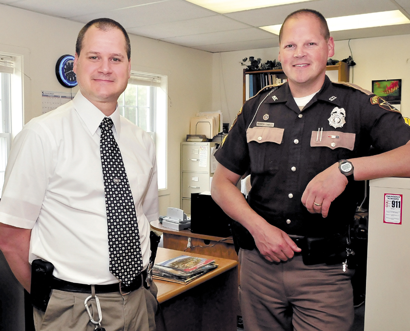Steve Charles, left, and his brother, Ken, have been promoted to detectives for the Franklin County Sheriff's Department in Farmington on Thursday.