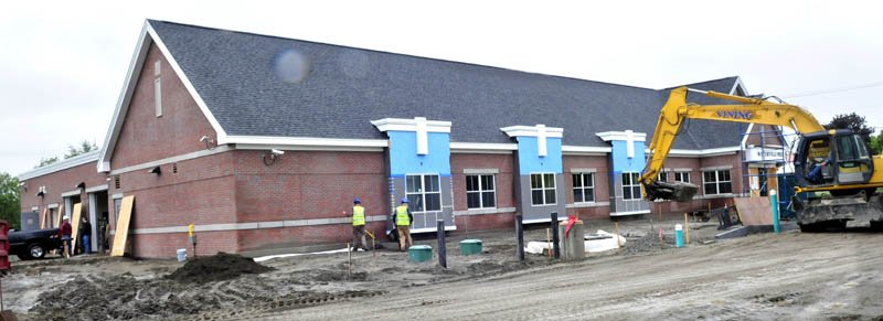 Workers construct the outside of the new Waterville police station on Colby Circle on Wednesday.