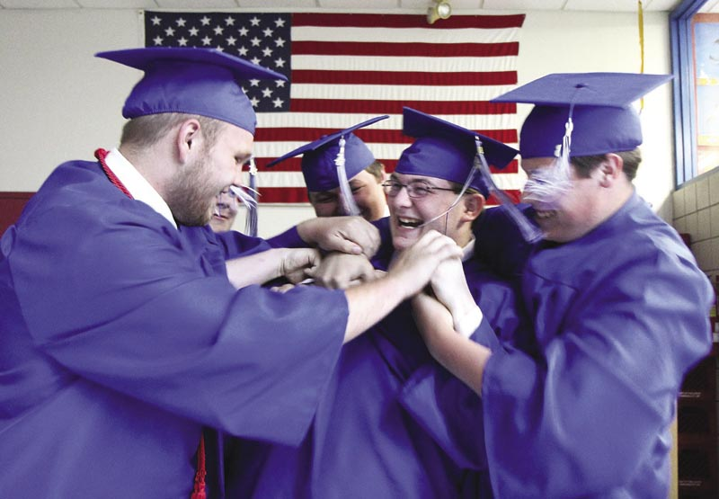 Richard Miller, center, gets a little tough love from Zakkary Bates-Moody, left, and several other friends before commencement exercises begin at Madison Area Memorial High School on Friday night.