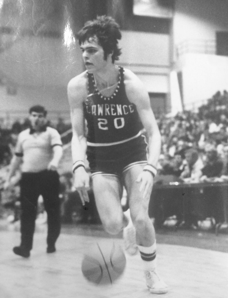 HALL OF FAME CAREER: Mike McGee dribbles up the court during the 1976 state championship game against Rumford at the Augusta Civic Center. McGee, who recently retired after a long career as the Lawrence High School basketball coach, will be inducted into the New England Basketball Hall of Fame for his playing career at the school.