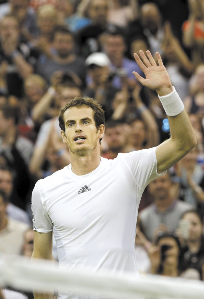 MOVING ON: Andy Murray celebrates after defeating Tommy Robredo at the All England Lawn Tennis Championships on Friday in Wimbledon, London.