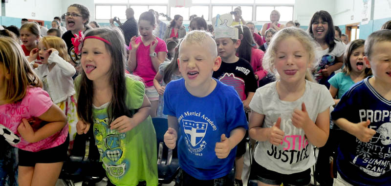 """Kids at Mount Merici Academy in Waterville take part in the school's traditional """"Tootie-ta"""" skit during an end of the year assembly on Thursday. Sticking out their tongues are, from left, Braelyn Doody, Michael Achorn and Briana Veilleux."""