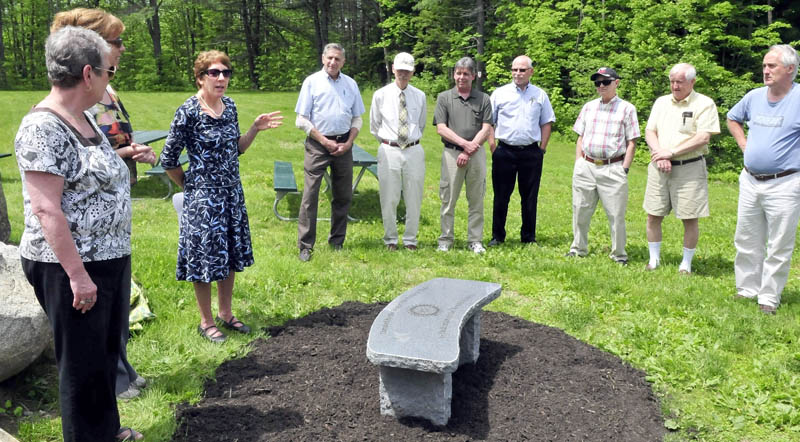 Waterville Rotary Club President Suzanne Uhl-Melanson gestures while dedicating a sitting bench in honor of the years of community service from the Willard B. Arnold family, at the Quarry Road Recreation Area in Waterville on Monday. The Arnold family has been involved with the club and local efforts since 1918. Bill Arnold was unable to attend the dedication.