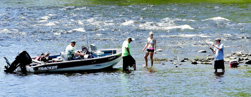 Some people may complain about the recent heat and humidity but these folks, armed with boat, fishing rods, bathing suit and a cooler, took advantage of summer conditions on the Kennebec River in Skowhegan on Sunday.