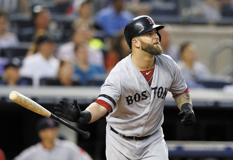 THAT'S OUTTA HERE: Boston's Mike Napoli watches his grand slam in the third inning of the Red Sox's win over the New York Yankees on Saturday in New York.