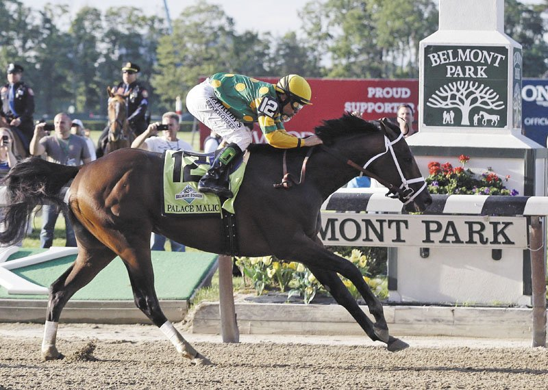 AND THE WINNER IS: Palace Malice, ridden by jockey Mike Smith, crosses the finish line to win the 145th Belmont Stakes on Saturday at Belmont Park in Elmont, N.Y.