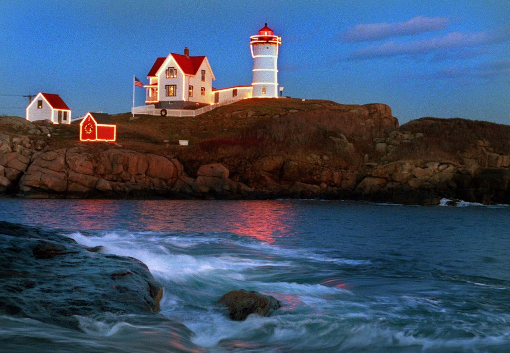 Nubble Light in York is illuminated by Christmas lights as the sun sets on Nov. 28, 1999.