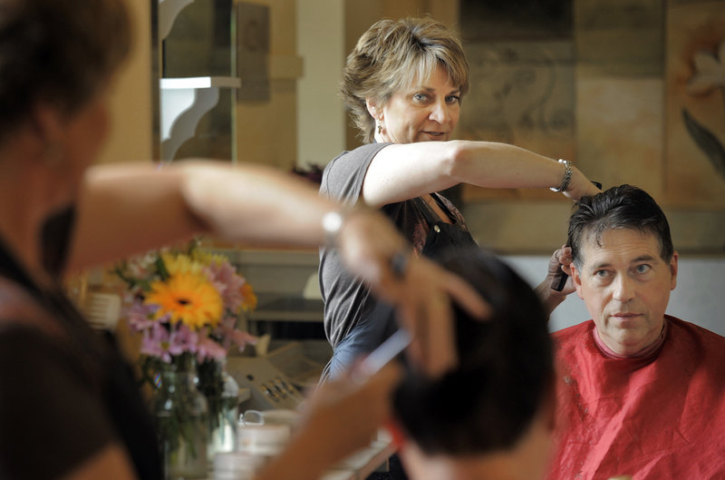 "Gabe Souza/Staff Photographer Holly Fent, shown cutting the hair of Peter McDonald of Scarborough at Hair It Is on St. John Street, recognizes that she can be a trusted "" sounding board,"" but technology has eroded the personal touch that helped protect privacy for the previous two centuries."