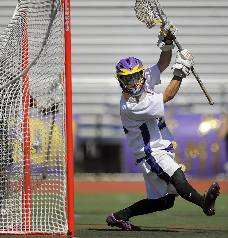Cheverus goalie James Biegel watches as a shot zips past him and into the net during the second half of Scarborough's 15-4 victory.