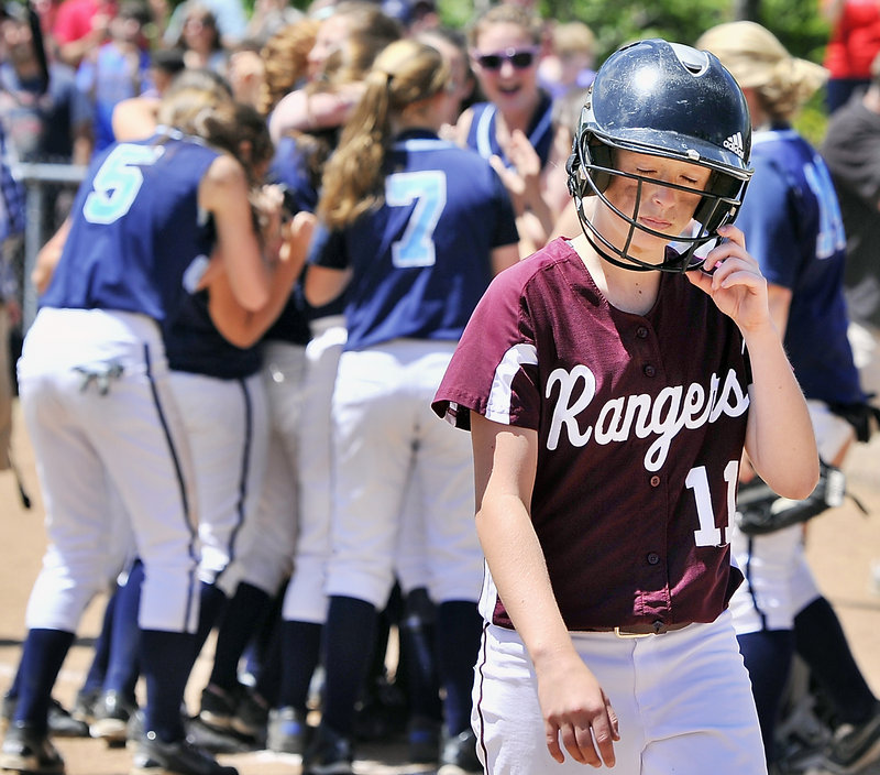 Sarah Felkel of Greely walks away as the game ends and Oceanside celebrates winning the Class B softball state championship at St. Joseph's College.