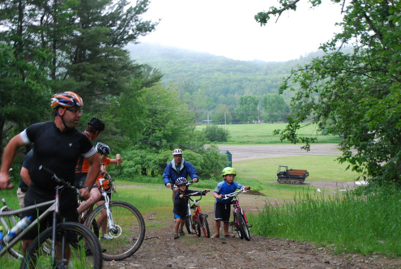 Participants in a free mountain biking camp for kids make their way up a hill at the Ragged Mountain Recreation Area in Camden. The camp was revived by Casey Leonard, who is coach of the Camden High School mountain bike team and father of an enthusiastic 5-year-old mountain biker.
