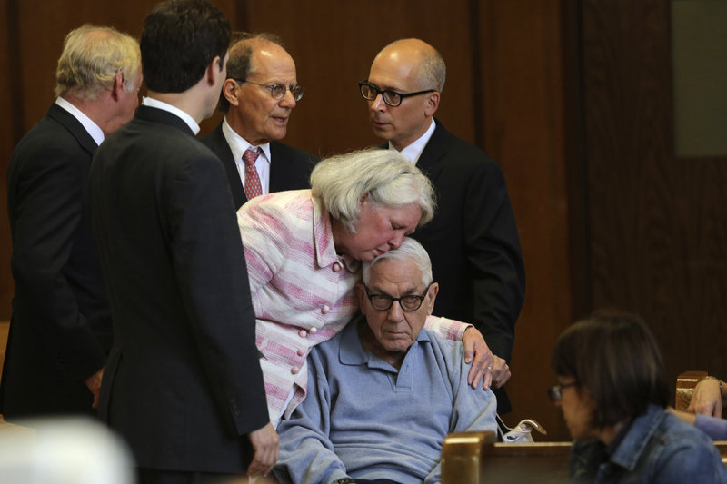 Anthony Marshall, 89, the son of deceased philanthropist Brooke Astor, is kissed by his wife, Charlene, as he arrives with his attorneys in a New York court on Friday.
