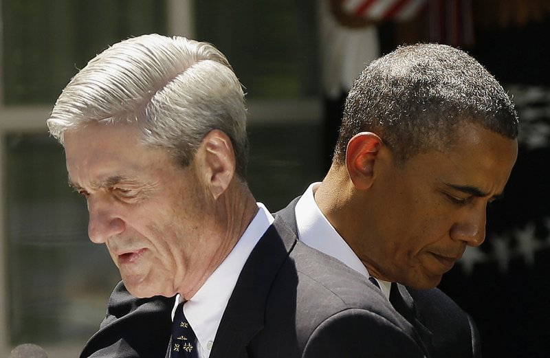 President Obama and outgoing FBI Director Robert Mueller are seen Friday in the Rose Garden of the White House in Washington, where the president announced he would nominate James Comey to replace Mueller as FBI director.