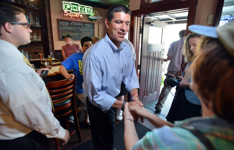 Gabriel Gomez, Republican candidate for U.S. Senate in the Massachusetts open seat special election, greets supporters, Monday, June 24, 2013, at the Four Square restaurant in Braintree, Mass. Gomez faces Democrat Rep. Ed Markey in Tuesday's election. (AP Photo/Josh Reynolds)