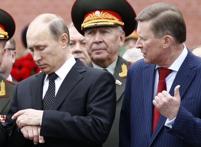 "Russia's President Vladimir Putin, left, shown at a ceremony in Moscow on Saturday, made it clear Tuesday that Russia won't expel Edward Snowden, who as a transit passenger ""is entitled to buy a ticket and fly to wherever he wants."""