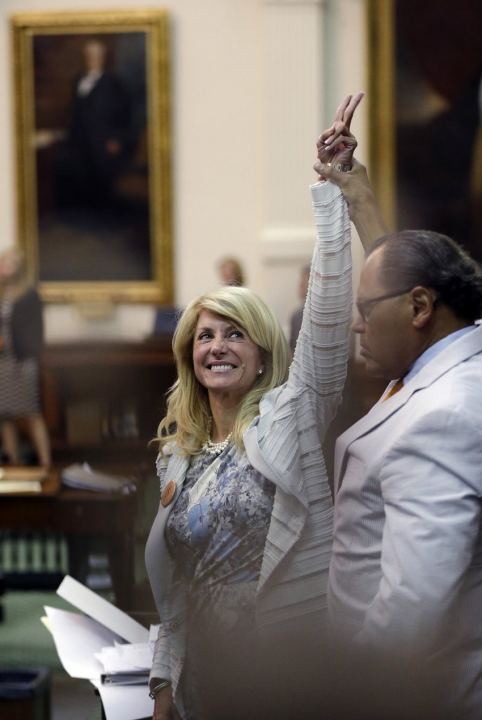 Sen. Wendy Davis, D-Fort Worth, reacts as time expires for a vote on proposed abortion restrictions early Wednesday in Austin, Texas. She delivered a filibuster for 13 hours, supported by hundreds of onlookers.