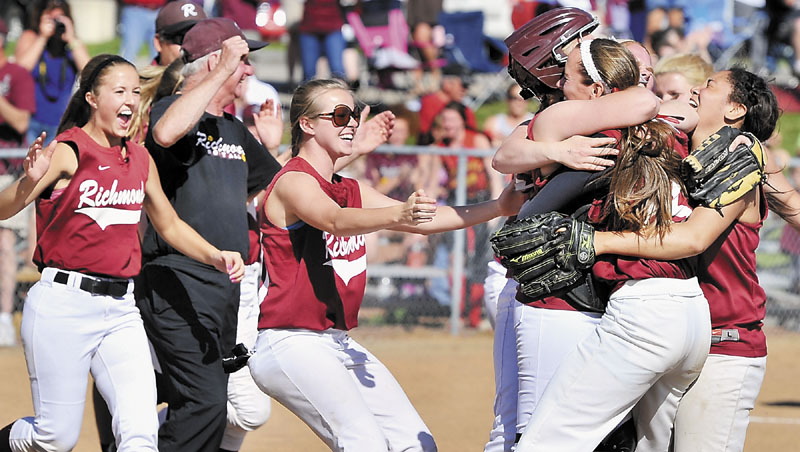 Richmond players gather around catcher Chika Obi and pitcher Jamie Plummer after the Bobcats beat Penobscot Valley in the Class D softball championship game Saturday in Standish.
