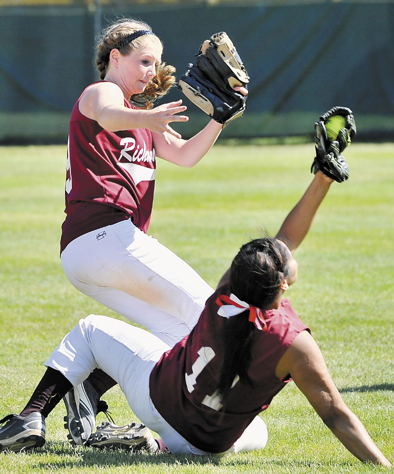 Richmond second baseman Kelsey Anair, left, and first baseman Kelsie Obi collide chasing a pop fly but Obi comes up with the catch during the Class D softball state championship game Saturday in Standish.