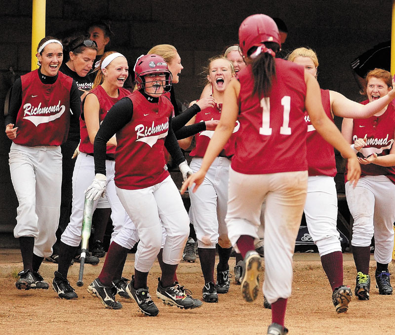 Richmond's Payton Johnson, third from left in batting helmet, celebrates after she scored the Bobcat's 12th run on groundout by Kelsie Obi, 11 center, in fifth inning to win the Western Maine Class D softball championship 12-0 on Thursday at Richard M. Bailey Field at St. Joseph's in Standish.