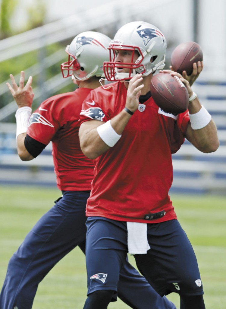 TRYING TO IMPRESS: Quarterback Tim Tebow drops back to throw a pass during New England Patriots mini-camp Wednesday in Foxborough, Mass.