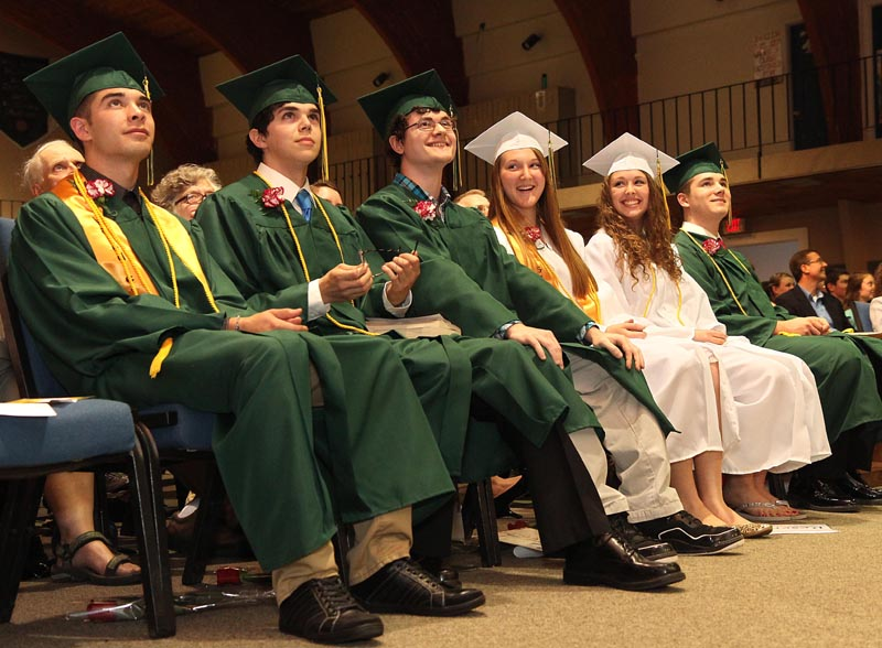 The six members of Temple Academy's Class of 2013 react to the senior DVD during commencement in Waterville on Sunday night. From left to right are Adam LaVerdiere, Timothy Dibden, Corey Achramowicz, Sara Bell, Rachael Desrosiers and Isaac Manley. LaVerdiere gave the valedictory address and Dean of Guidance Elise Rossignol gave the commencement address.