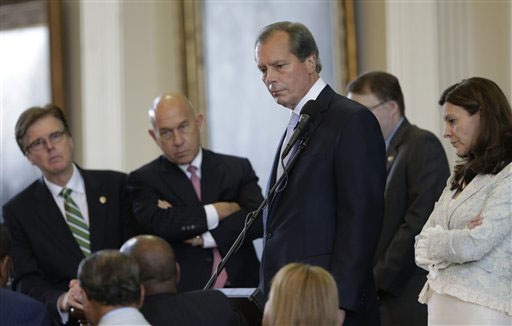 Texas Lt. Gov. David Dewhurst, center, conferences with senators over a point of order during Sen. Wendy David's filibuster of a bill limiting abortions on Tuesday.
