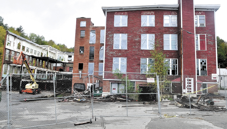 Worers demolishing the former Forster Manufacture building in Wilton in July 2011. Demolition of the mill was halted in when workers alerted federal officials to what was described by one official as the worst case of asbestos in the state in 30 years