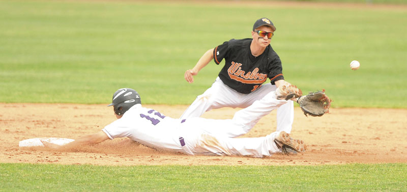Waterville Senior High School's Tyler Bouchard, 12, slides into second base before the ball can get to Winslow High School second baseman Taylor Roy, 11, in the seventh inning at Mansfield Stadium in Bangor on Thursday. Winslow faces York for the Class B state title Saturday.