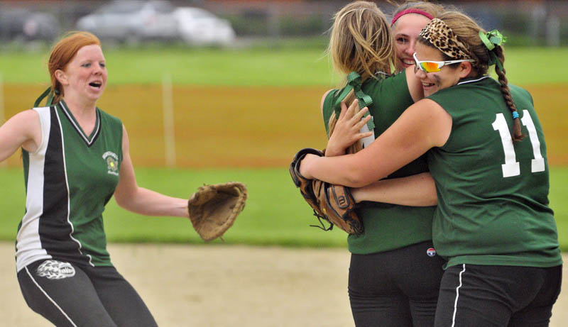 WE DID IT: Winthrop's Danielle Pease, left, runs in to hug teammates Krissy Doughty, Abby Helm and Alyssa Arsenault after the Ramblers beat Hall-Dale 3-2 in a Western Class C quarterfinal game Thursday in Farmingdale.