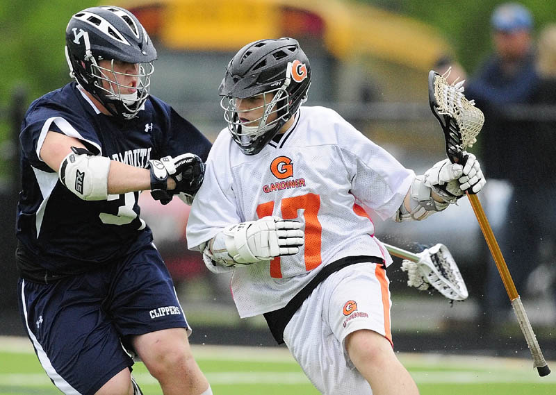 MAKE A RUN: Yarmouth's Thomas Lord, left, tries to stop Gardiner's Dalton Sargent during Eastern Maine Class B boys lacrosse regional final Wednesday at Thomas College in Waterville. Yarmouth beat Gardiner 15-3.