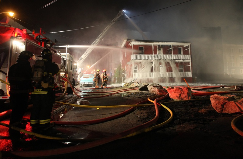 Firefighters battle a blaze early on May 4 that destroyed apartment buildings in Lewiston. The boy who is accused of setting the fire has been ordered held at a treatment facility until his court hearing.