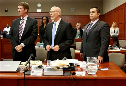 Defense attorneys Mark O'Mara, left, Don West, center, stand with George Zimmerman during Zimmerman's trial in Seminole circuit court, in Sanford, Fla., Wednesday, July 3, 2013. Zimmerman is charged with second-degree murder in the 2012 fatal shooting of slain teen Trayvon Martin.