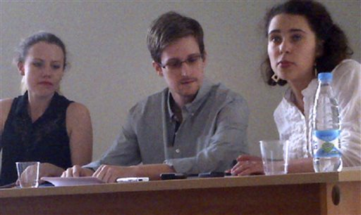In this image provided by Human Rights Watch, NSA leaker Edward Snowden, center, attends a news conference at Moscow's Sheremetyevo Airport with Sarah Harrison of WikiLeaks, left, Friday. At right is Tatiana Lokshina, deputy head of the Russian office of Human Rights Watch.
