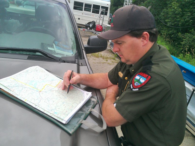 Lt. Kevin Adam of the Maine Warden Service goes over the route of the agency's search today for Geraldine Largay, 66, of Tennessee, who went missing on the Appalachian Trail between Rangeley and Wyman Township last week.