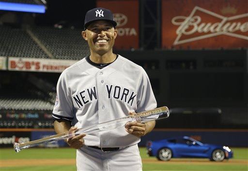 MVP: Mariano Rivera poses with the MVP trophy after the MLB All-Star baseball game on Tuesday in New York. The American League defeated the National League 3-0.