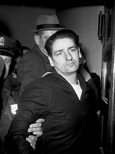 This Feb. 25, 1967, photo shows self-confessed Boston Strangler Albert DeSalvo minutes after his capture in Boston. DeSalvo confessed to the string of 1960s killings but was never convicted. He died in prison in the 1970s.