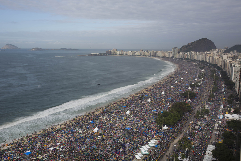 People pack Copacabana beach for Pope Francis' Mass on Sunday in Rio de Janeiro, Brazil. .