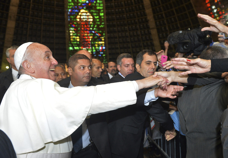 Pope Francis greets Argentines inside the Metropolitan Cathedral in Rio de Janeiro, Brazil, on Thursday.