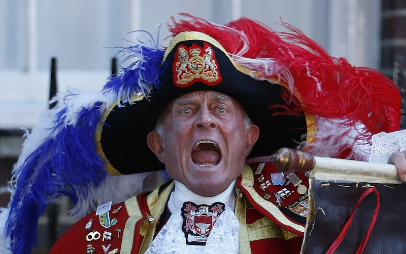 Tony Appleton, a town crier, announces the birth of the royal baby, outside St. Mary's Hospital exclusive Lindo Wing in London, Monday. Palace officials say Prince William's wife, Catherine, has given birth to a baby boy. The baby was born at 4:24 p.m. and weighed 8 pounds 6 ounces. The infant will become third in line for the British throne after Prince Charles and William.