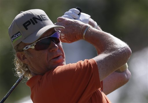 Miguel Angel Jimenez of Spain plays a shot off the 10th tee during the second round of the British Open Golf Championship at Muirfield, Scotland, Friday.