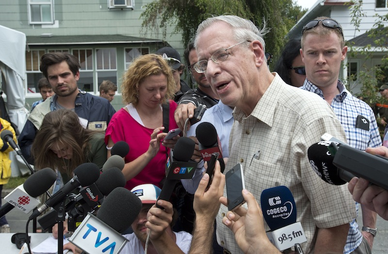 Rail World Inc. president Edward Burkhardt speaks to the media as he tours Lac-Megantic, Quebec, on Wednesday, July 10, 2013. A Rail World train crashed into the town killing 47 people. Burkhardt blamed the accident on an employee who he said had failed to properly set the brakes. (AP Photo/The Canadian Press, Paul Chiasson)