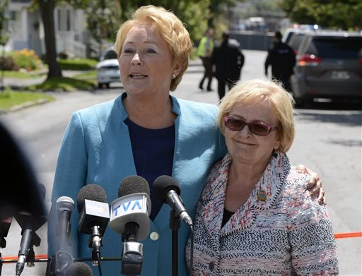 Quebec Premier Pauline Marois, left, and Lac-Megantic Mayor Colette Roy-Laroche speak during a news conference Thursday in Lac-Megantic, Quebec.